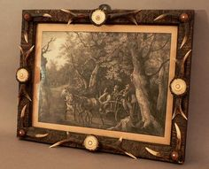 a carved wood antler wall picture frame