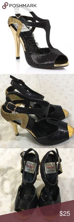 "🆕 Bettie Page by Ellie Shoes gold/black heels 7 Sexy, sparkly, strappy heels from Bettie Page by Ellie Shoes. Retro style. All synthetic materials. New in box. Black and gold sparkles. 4"" heel.  Arrived with small scuff on toe of right I sold (last photo).  Size is 7, but it feels like it runs a bit small. So if you are a 6.5 or a small 7 (with a narrow or medium width foot), these should fit great! Bettie Page Shoes Heels"