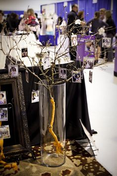 A branch, craft flowers and birds from Michael's. Display that shows off images.