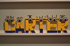 Purchase these cute minion paper mache letters from Etsy. http://www.etsy.com/shop/CraftingCrew?ref=search_shop_redirect