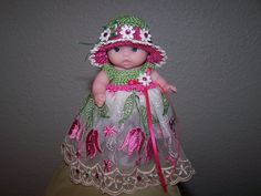 # 703 Beautiful spring lace with tulips and matching hat.