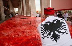 A chef cuts a huge cake, with the Albanian flag symbols, measuring 550 sq meters, on the main boulevard of Tirana, Albania, during celebrations of 100 years of independence. Nov 28, 2012