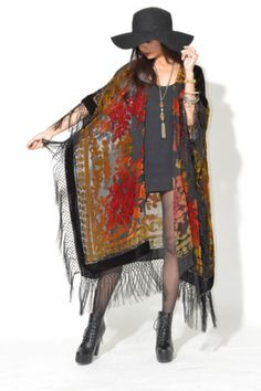 Gorgeous vintage inspired burnout velvet cape jacket.      *  Draped style that will fit most sizes *  Fringe all around hem *  Open style front *  Sheer *  Hand made  *  Imported fabric  Bust: Free Waist: Hips: Length: 51  Contents: silk, rayon Color: Black with Red and Gold tones...