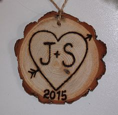 """Personalized Heart Rustic Tree Ornament. Beautifully rustic, eco-friendly tree slice Christmas or holiday ornament, pyro-engraved by hand with 2 initials of your choice inside a heart with the year engraved on the bottom. Each monogrammed tree slice measures approx 3"""" to 4"""" in diameter, as they are an all natural product, there will be slight variances. . These rustic but oh so chic, ornaments make great housewarming, wedding, first home, or anniversary gifts too! Enter your initials in…"""