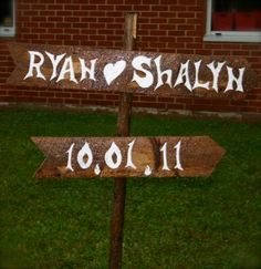 my husband made these signs for our wedding out of his Granddaddy's barn boards ♥