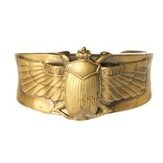 On my wish list: Reclaimed metal scarab cuff. In Egyptian Mythology the scarab was said to represent transformation, renewal & resurrection
