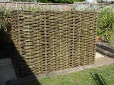 Oil tank cover up - could something similar be devised for wheelie-bin storage? Willow Fence, Willow Garden, Small Front Gardens, Back Gardens, Small Space Gardening, Garden Spaces, Bin Storage Ideas Wheelie, Living Willow, Hot Tub Garden