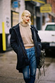 A cropped sweater with a big, warm parka over the top and a pair of slouchy skinny jeans via Vanessa Jackman.