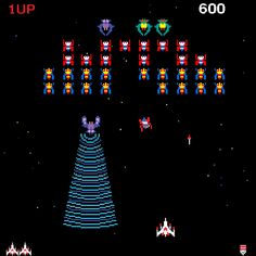 Galaga. There's one or two places today that this game can be found. And I can't resist playing.