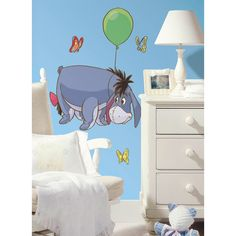 """This colorful wall decal of Pooh's gloomy friend will have your little ones saying, """"Cheer up Eeyore."""" This fun and exciting wall decal is perfect for nurseries and bedrooms, and parents will love how easy it is to apply and remove."""
