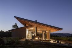 This sleek tasting room at L'Angolo Estate, a family-operated winery in Newberg, Oregon, takes advantage of its lush vineyard landscape by way of its architecture. Architecture Design, Sustainable Architecture, Floating Architecture, Classical Architecture, Ancient Architecture, Landscape Architecture, Butterfly Roof, Wine Tasting Room, Contemporary Style Homes