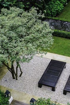 Love the black outdoor furniture against the graded pebbles. Pinned to Garden Design by Darin Bradbury.