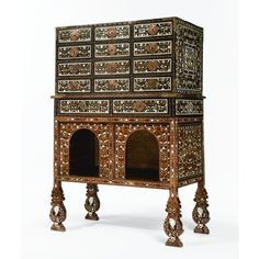 A fine and rare Indo-Portuguese gilt-copper-mounted ivory inlaid hardwood Cabinet on Stand (Contador)<br>late 17th century, Goa | Lot | Sotheby's