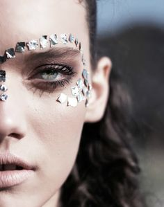 Cool makeup look! I feel like this would be a technology or mining district-inspired look for The Hunger Games... :3
