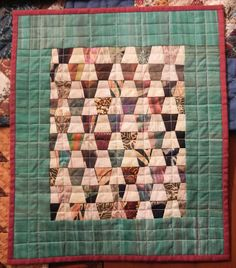 """Tumbler quilt - 12""""X14""""; paper pieced by Barbara"""