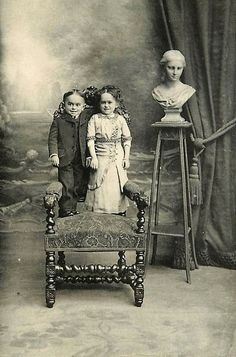 The Little Couple    Here is an old postcard from my collection of a happy young couple posing on an ornate old chair in a studio setting. These two were gainfully employed as a sideshow attraction during the 19th century.