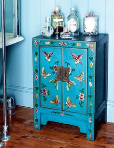 blue painted Chinese console cabinet with butterflies