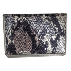 """Lodis Silver Sequin Cairo Mini Wallet Card Holder Lodis Mini Wallet/Cardholder purchased at Nordstrom. Perfect for holding business cards, credit cards, gift cards, etc. Grey/silver sequined snakeskin pattern called """"Cairo."""" Silver leather logo stamped interior with pocket and mirror. Condition is excellent, barely used. 4.25"""" x 3"""" x .5"""" Lodis Bags Wallets"""
