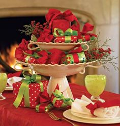 When you're tight on time, take advantage of what's plentiful. Simply gather small wrapped presents, a tiered pedestal, and some holly or other greenery. Within minutes, you'll have a #christmas centerpiece that will last the entire season (or at least until the gifts are opened).