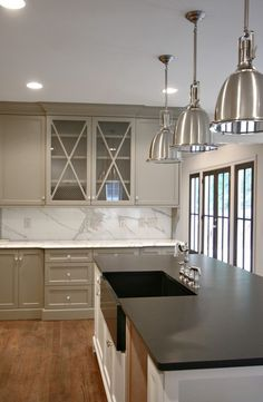 Kitchen palette of white, grey, wood & chrome fixtures/ fittings (possibly dark paperstone countertop @ island)