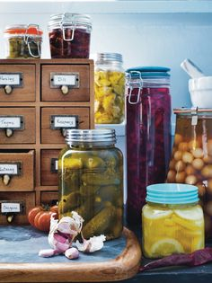 Rosemary & Thyme. Pickles in brine, jars and jars of marmalade standing up in a line.