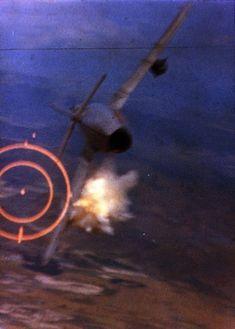 An F-105D shoots down a MiG-17 during the Vietnam War June 1967.