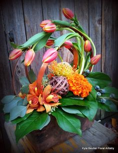 Tulips, orchids, pincushion protea, marigolds, copper wire. Kyla Beutler Floral Artistry callalily01@hotmail.com