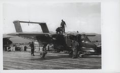 """OV-10 Bronco Observation Aircraft, 1969  """"An Hoa: Captain Calvin A. Lloyd (New Berlin, New York) and 2d Lieutenant Courtney C. Schron (Chagrin Falls, Ohio) (atop the aircraft) check their OV-10 Bronco Observation Aircraft for possible damage from enemy fire. The Marine aviators had just landed at the An Hoa airstrip after flying in support of the Marines fighting on the ground in Operation Taylor Common, 22 miles southwest of Da Nang (official USMC photo by Staff Sergeant Bob Jordan).""""…"""