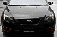 Front of Ford Focus ST 2 with orange elements #Ford #Focus #ST #RS