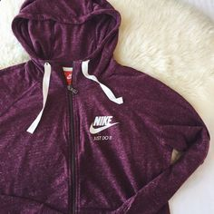 Nike Burgundy Gym Vintage Hoodie •The Nike Gym Vintage Full-Zip Womens Hoodie delivers everyday comfort with soft, lightweight fabric. •Size Medium and Large available. True to size. •New with tag. •NO TRADES/PAYPAL/MERC/HOLDS/NONSENSE. Nike Tops Sweatshirts  Hoodies