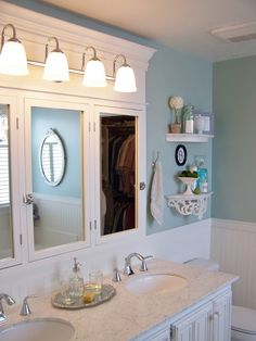 Bathroom reno for $1200 mirrors double as storage....love the cape cod style