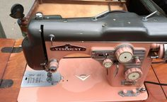 vintage sewing machine with all the bells and whistles