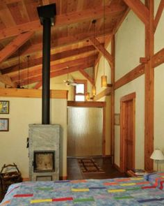Wood on the ceilings, eaves and baseboards for this straw bale home was reclaimed from a local mill.