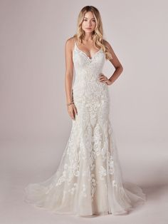 25474 - Adelaide - Go full beach mode in this romantic mermaid wedding dress. (Even the lace motifs look like seashells and sunset waves!)   Try this beauty on at Aurora Bridal in Melbourne, FL 321-254-3880