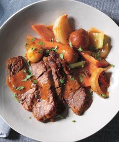 The beef chuck roast—a tough yet flavorful cut—becomes melt-in-your-mouth tender as it cooks with the vegetables. Get the recipe for Slow-Cooker Classic Pot Roast.