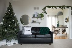 Love this modern Christmas home tour! It's a simple way to mix natural elements with black and white and teal for a classic, modern holiday look! Modern Christmas, Rustic Christmas, Beautiful Christmas, Christmas Home, Christmas Trees, Easy Christmas Ornaments, Christmas Decorations, House Decorations, Above Couch