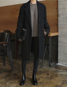 grey sweater, black overcoat, black trousers, black leather booties