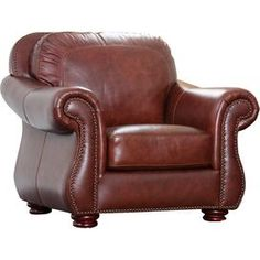 """Perfect as an accent for the living room seating group or your reading nook decor, this handsome leather arm chair showcases nailhead trim and rich burgundy upholstery.   Product: ChairConstruction Material: Kiln-dried hardwood, high-density foam and semi-aniline top grain leatherColor: Burgundy Features:  Nailhead trimHand-stitched details19"""" Seath height 22"""" Seat depthDimensions: 38"""" H x 43"""" W x 39"""" D; J&M"""