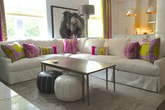 White outdoor velvet by Perennials on sectional w/ colorful Designers Guild accents by Fiona Newell Weeks for Dwelling & Design