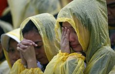 Pope Francis in Tacloban, Leyte, Jan. - A faithful cries during a mass led by Pope Francis ear Tacloban Airport on Jan. Storms greeted Pope Francis when he arrived in the central Philipines city of Tacloban on Saturday, Philippines Cities, Leyte, Religion And Politics, Image Of The Day, Pope Francis, Natural Disasters, Quotes To Live By, Jan 17, Storms