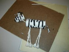 Zebra marionette from toilet paper rolls, very clever.