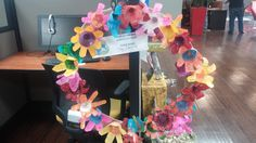 This Earth Day project is a pretty spring wreath made out of recycled paper.