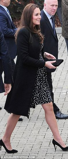 Looking good: The Duchess of Cambridge cut a glamorous figure in her cheap chic maternity dress by online retailer ASOS