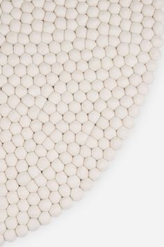 The elegant Linéa Felt Ball Rug was designed for the German label myfelt. The Linéa Felt Rug by myfelt is assembled from uni-coloured felt balls to create a gorgeous carpet. The round rug measures a diameter of Ø 120 cm and is wonderfully suited for use i