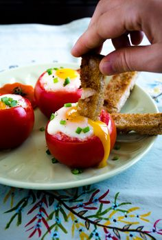 Egg Stuffed Tomatoes into each cored tomato place 1 tsp butter, 1 cracked egg, salt & pepper to taste. bake on parchment lined baking sheet 25-30 minutes @ 375 f. garnish with chopped green onion