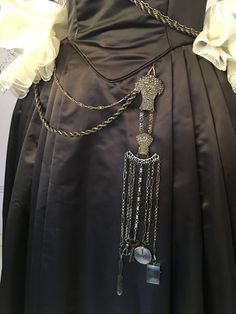 Châtelaine, a woman who owns or controls a large house (a feminine form of Châtelain). Chatelaine (chain), a set of short chains on a belt worn by women and men for carrying keys, thimble and/or sewing kit, etc.