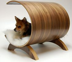 Dog Pod Lounge... This has got to be the most stylish doggy beds I have ever seen. More of a recliner than a pet bed, It's like an Eames chair for your best friend. Bent ply with a Wood Veneer. Removable, washable pad. Suitable for small dogs. Retails for $598.