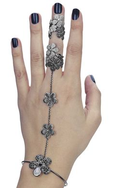 Colette's flower hand jewel wraps around the wrist and middle finger in a fashionable mix of black and white diamonds. See it at the Couture Show Las Vegas.
