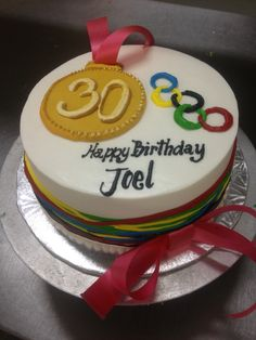 Colored ribbons Olympic themed 30th birthday cake with gold medal
