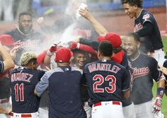 Cleveland Indians celebrate Francisco Lindor at home plate in celebration of his 10th inning walk off homer against the Toronto Blue Jays, July 22, 2017, at Progressive Field. (John Kuntz, cleveland.com)